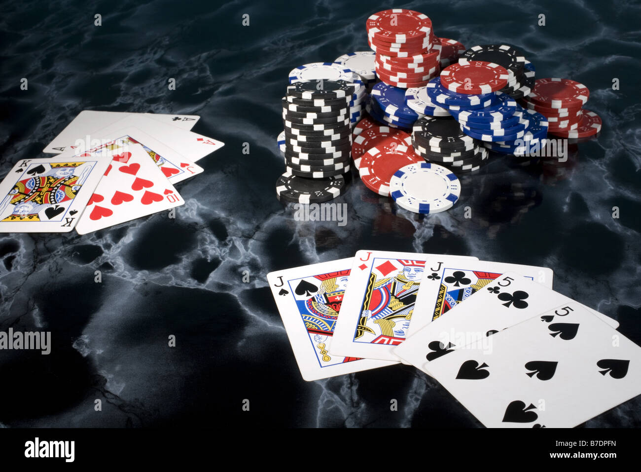 poker hands, a full house with pile of chips - Stock Image