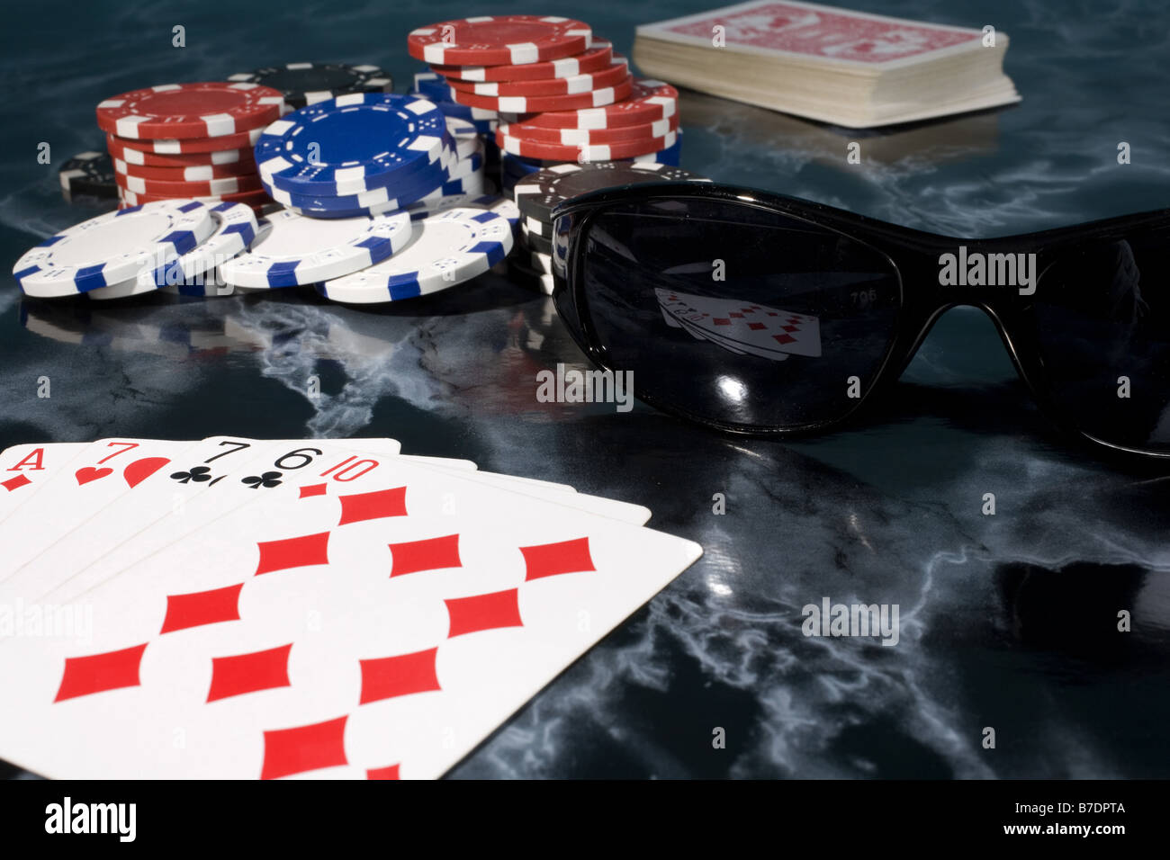 poker hands with pile of chips - Stock Image