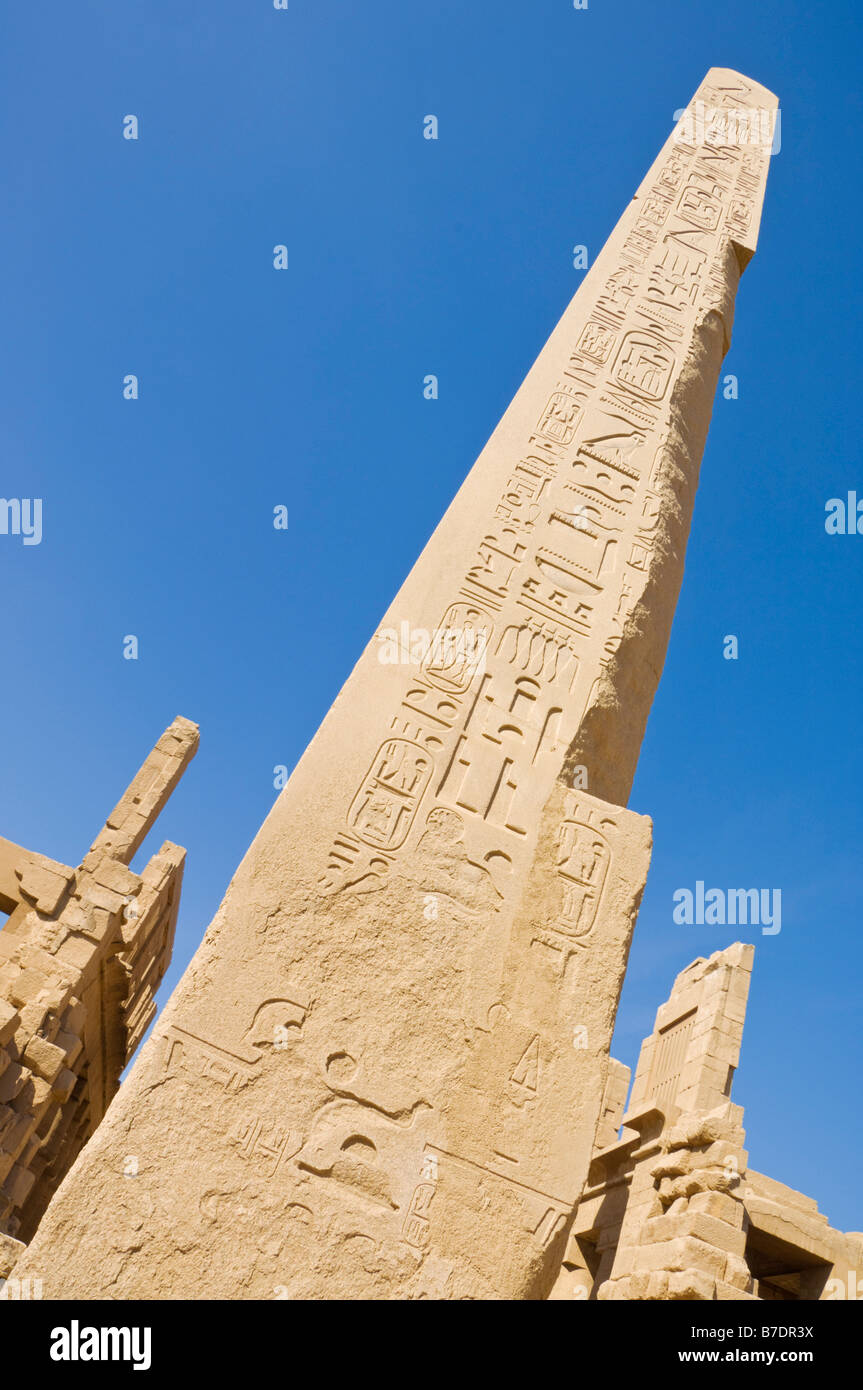 Granite obelisk column decorated with hieroglyphics at Karnak temple Luxor Egypt MiddleEast - Stock Image