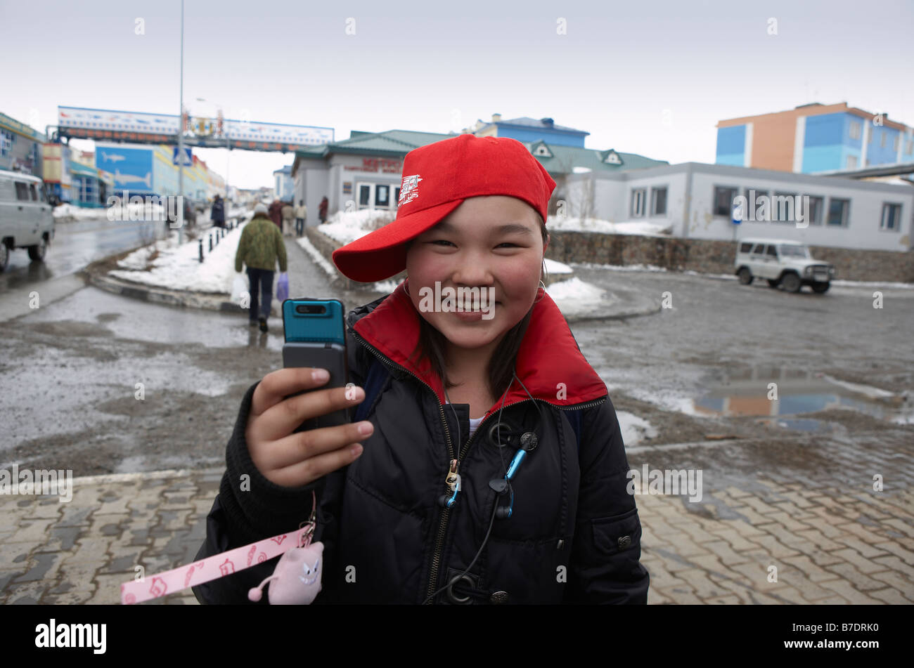 Teenager girl with cell phone, Anadyr Chukotka, Siberia Russia - Stock Image