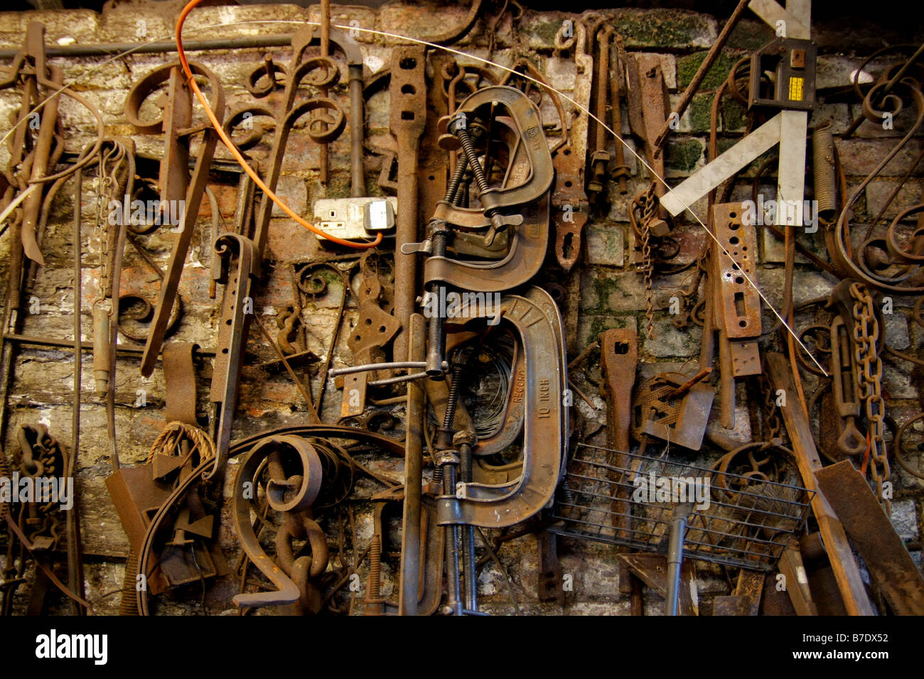 Old tools on a blacksmith s wall - Stock Image