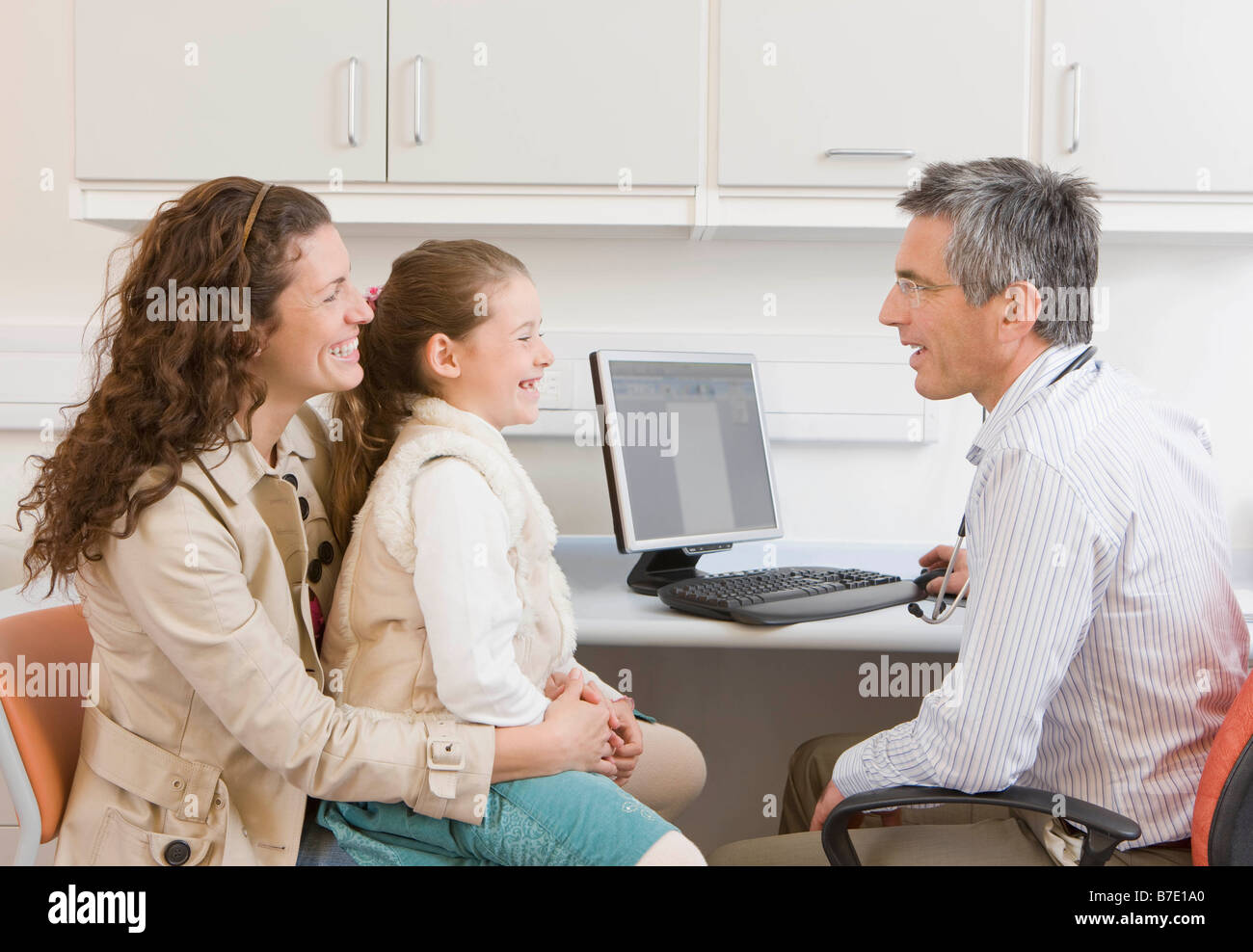 A mother and daughter visit the doctor Stock Photo