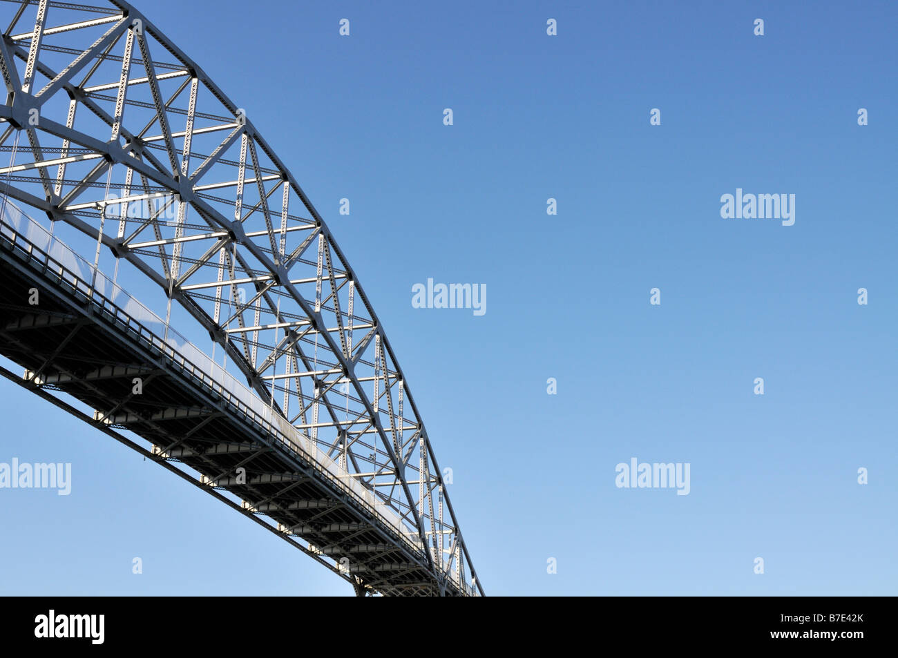 Abstract view of a bridge taken from below looking up Bourne Bridge over the Cape Cod Canal - Stock Image