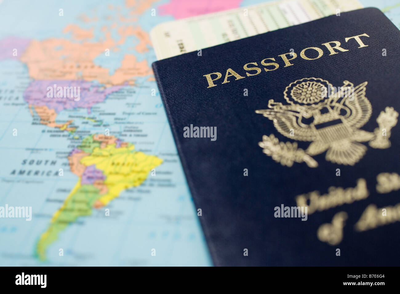 Airplane tickets passport and a map - Stock Image