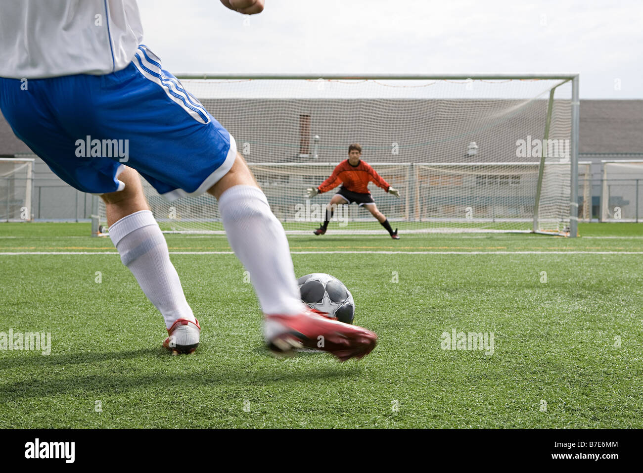 Footballer and goalkeeper - Stock Image