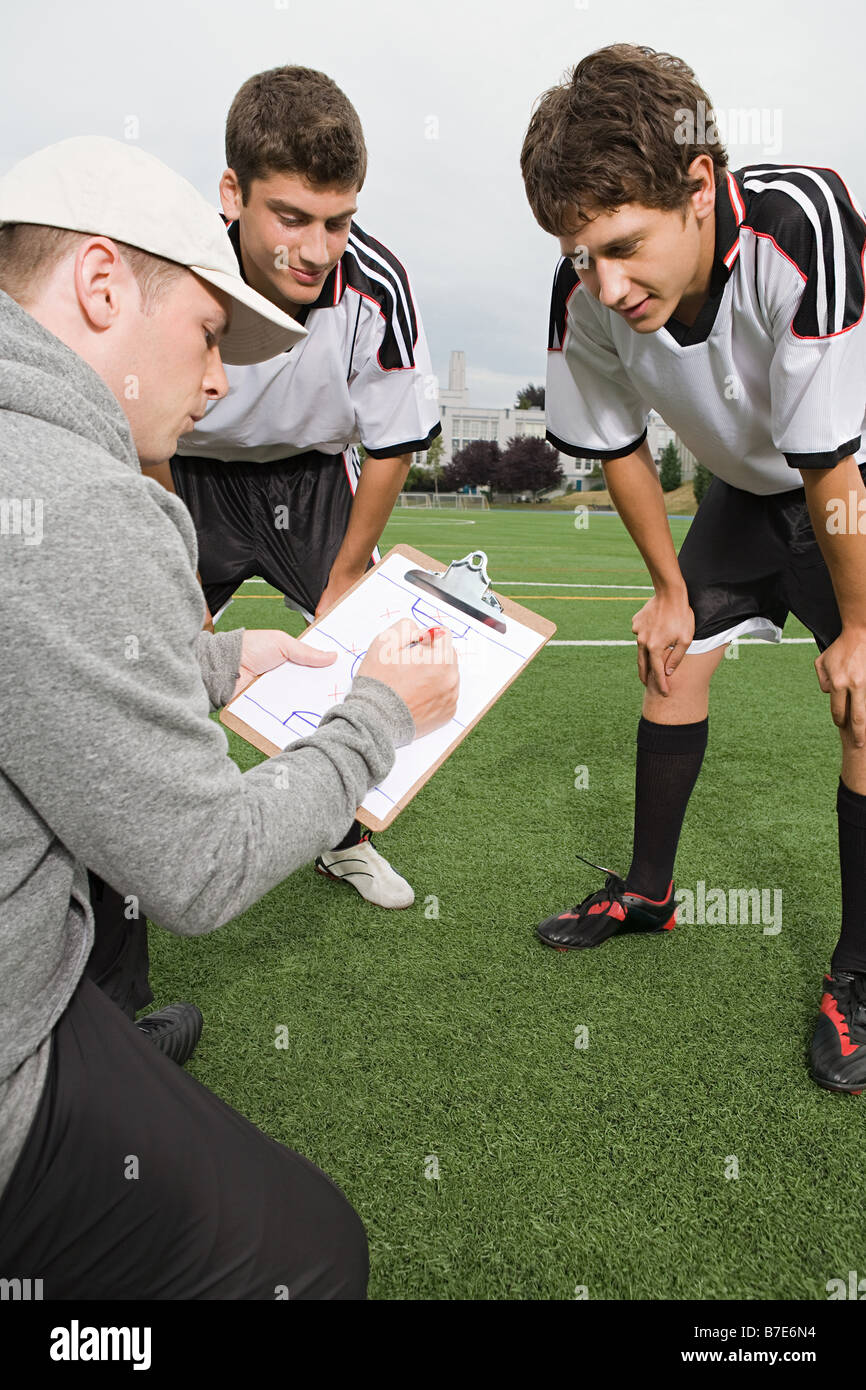 Football team and coach - Stock Image