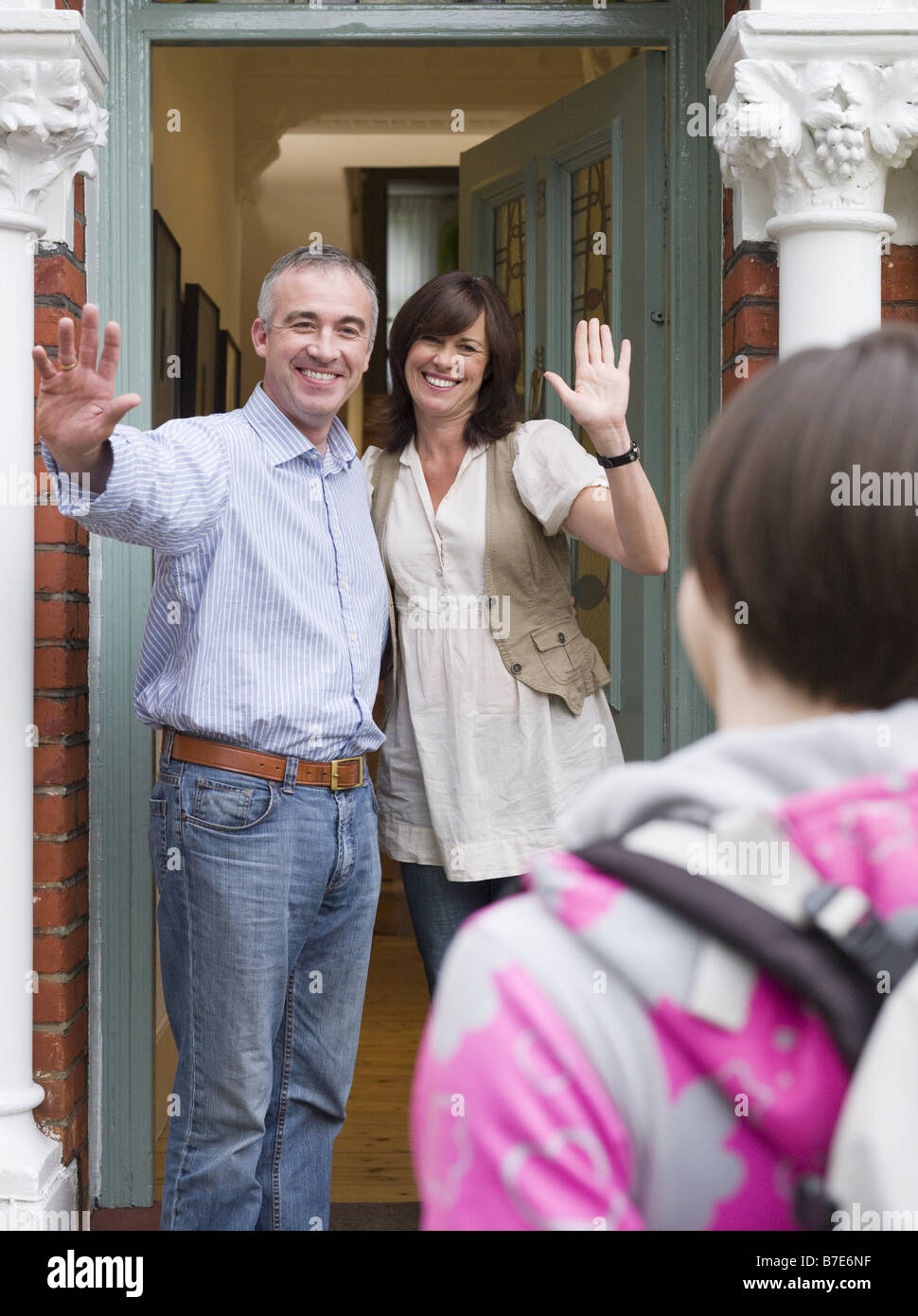 Parents greeting their daughter - Stock Image