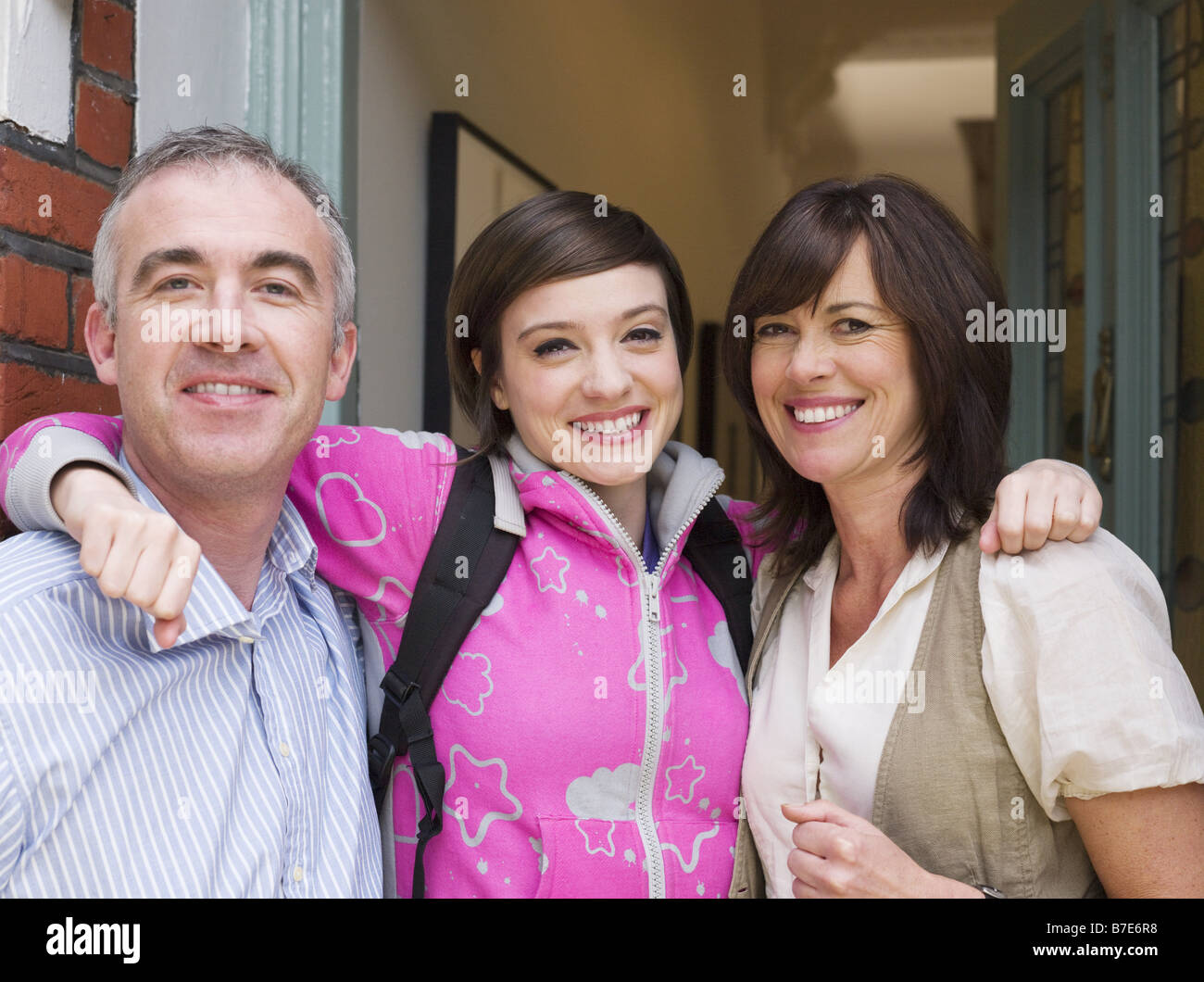 Portrait of a daughter with her parents - Stock Image