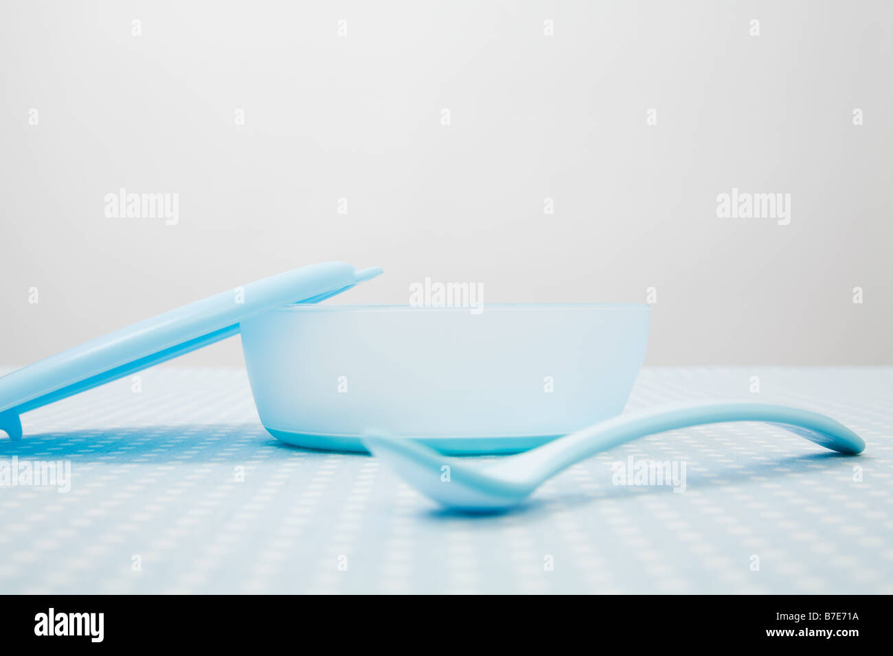 Baby bowl and spoon - Stock Image