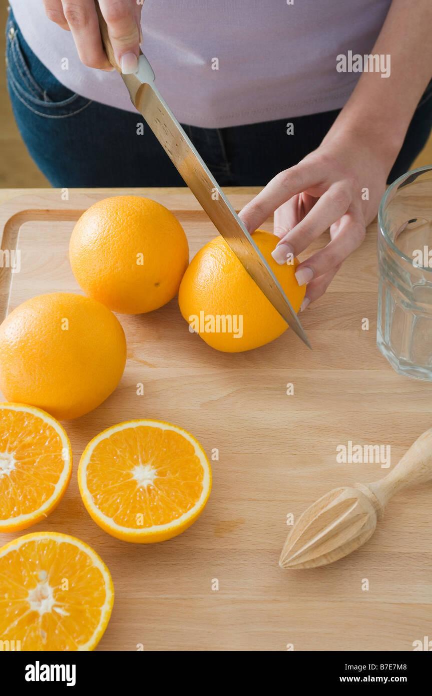 Woman cutting oranges Stock Photo