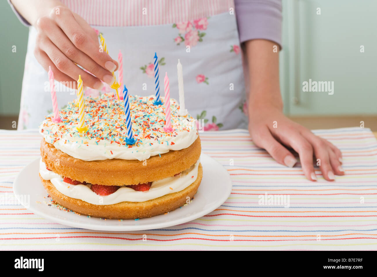 Woman with birthday cake - Stock Image