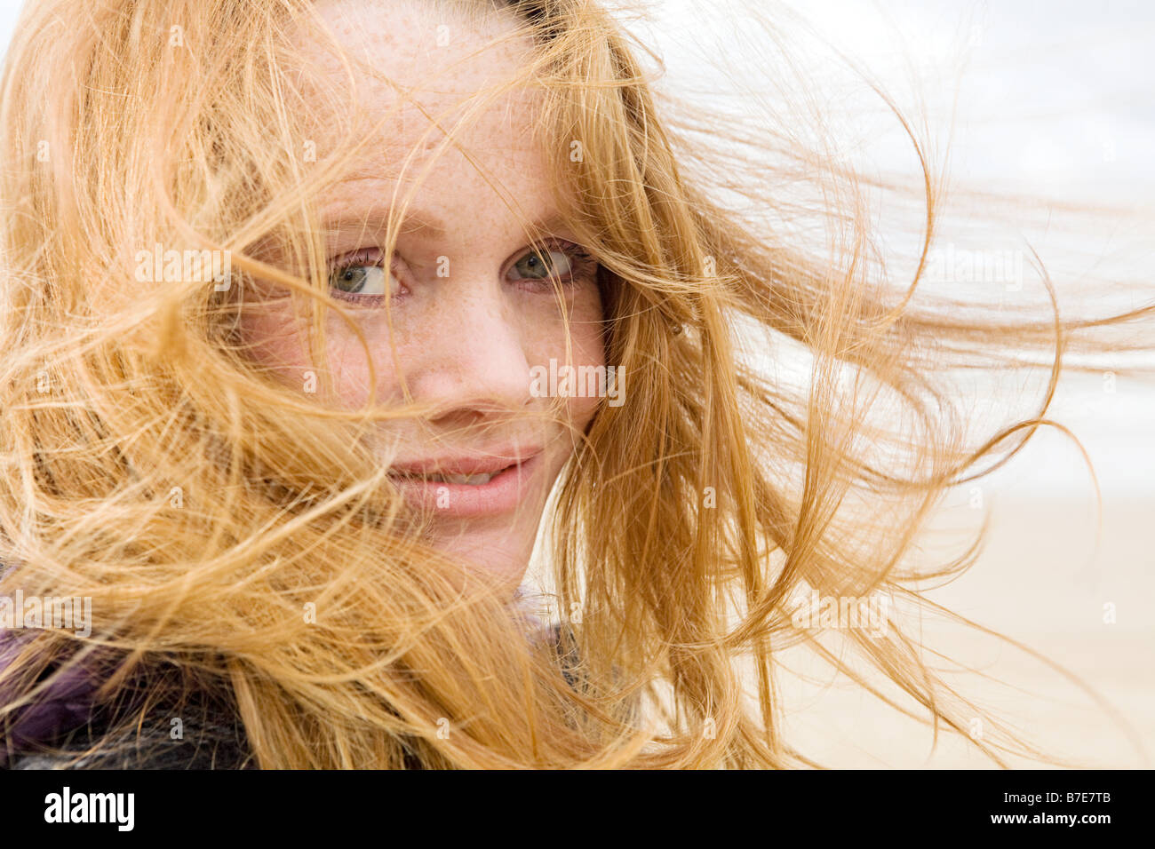Woman with hair blowing in breeze - Stock Image