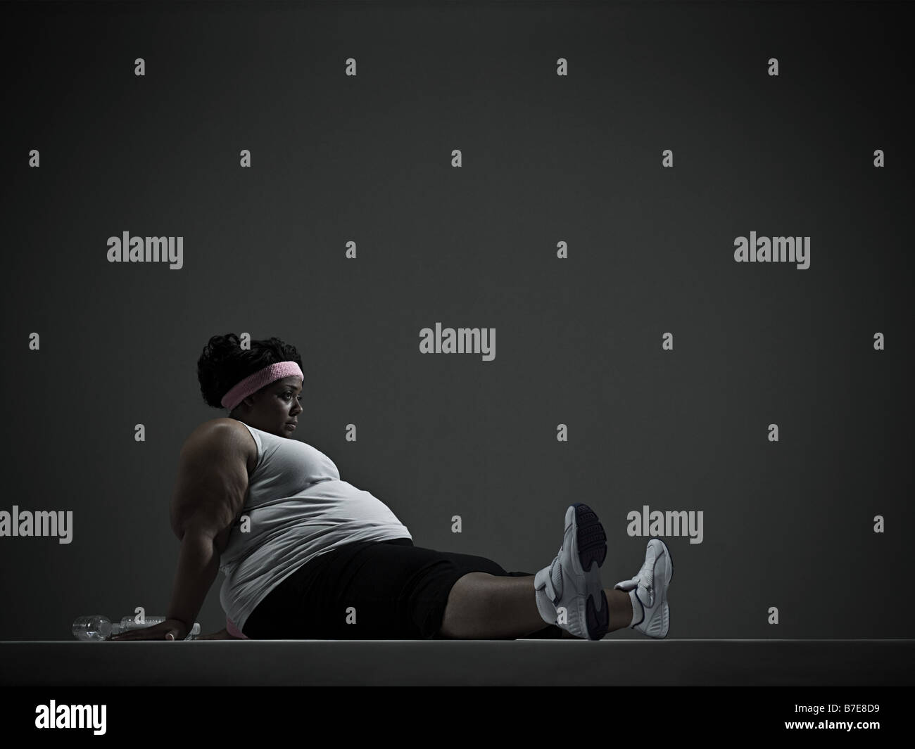 Overweight woman in sports clothing - Stock Image