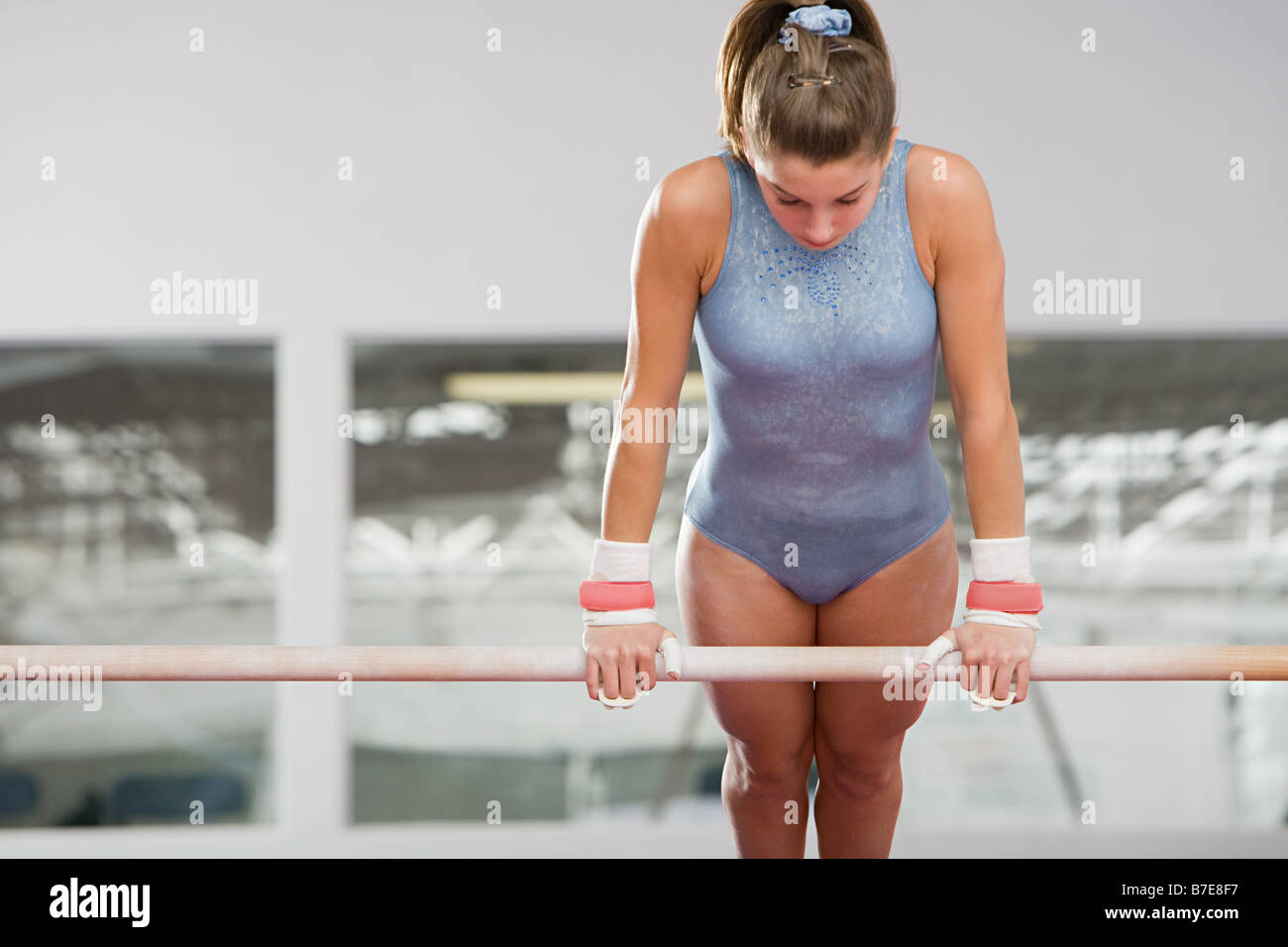 Gymnast on an uneven parallel bar - Stock Image