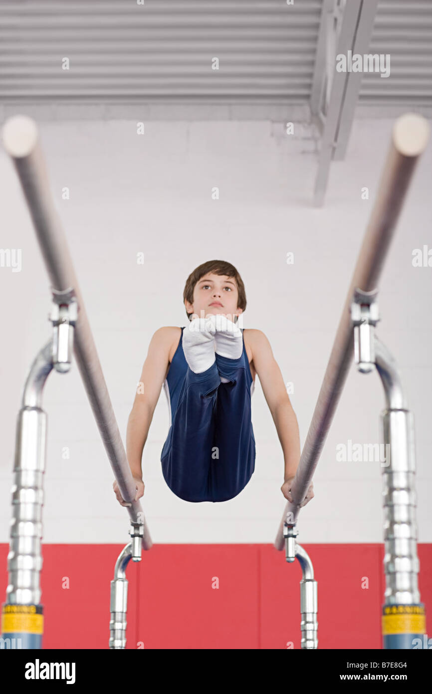 Gymnast on parallel bars - Stock Image