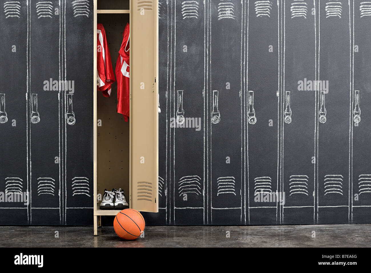 Basketball uniform hanging in a locker Stock Photo