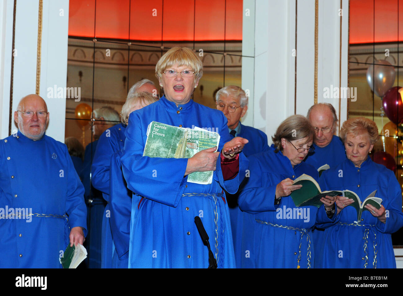 Bradford Choir sing carols at a Christmas Party West Yorkshire - Stock Image