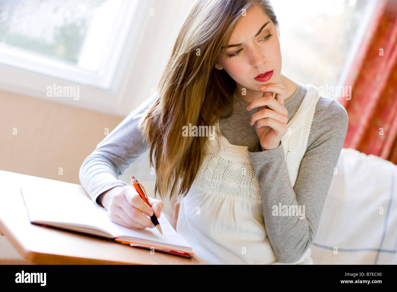Girl writing in diary - Stock Image