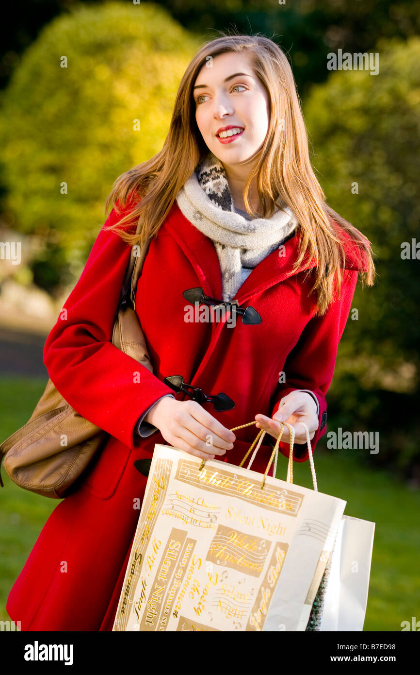 Young woman with shopping bags - Stock Image
