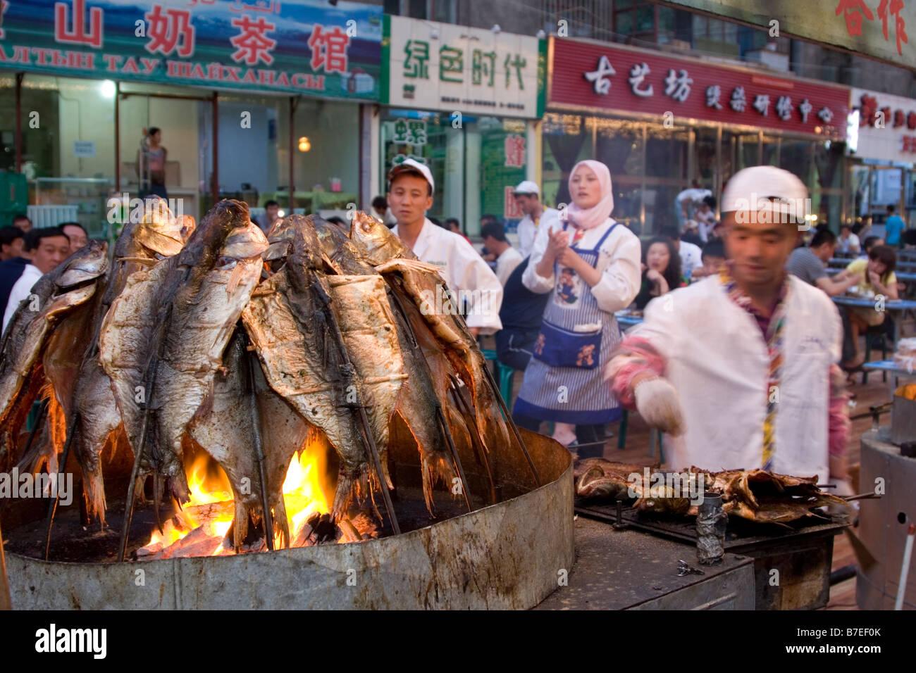 Grilling fish at the night market in Urumqi in Xinjiang in China Stock Photo: 21832067 - Alamy