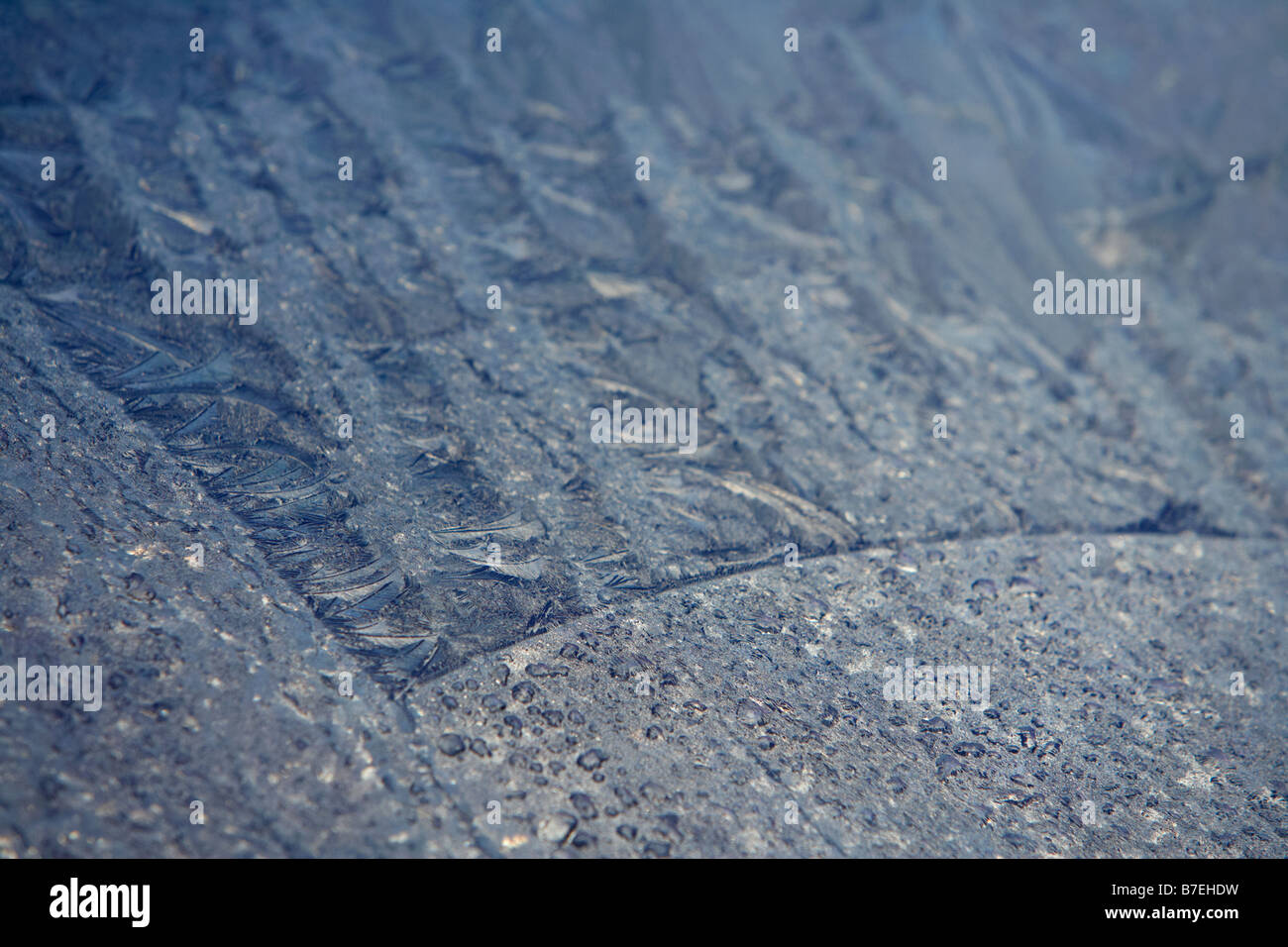 frost on a car windscreen on a cold frosty morning - Stock Image