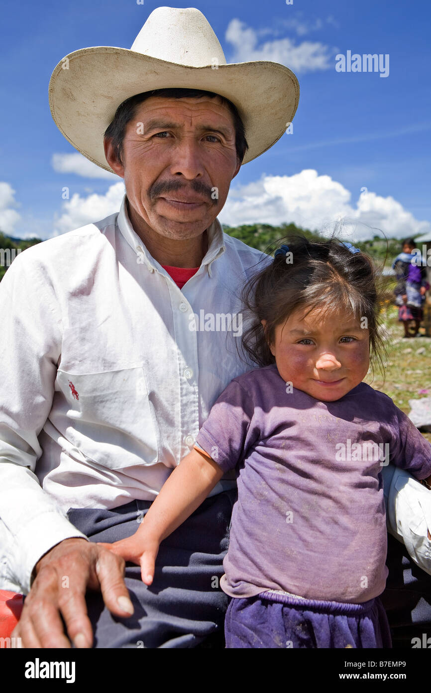 Guatemalan man poses with his daughter outside church San Nicolas Western Highlands Guatemala - Stock Image
