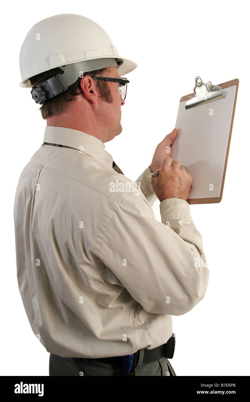 a view over the shoulder of a construction inspector checking his list isolated - Stock Image