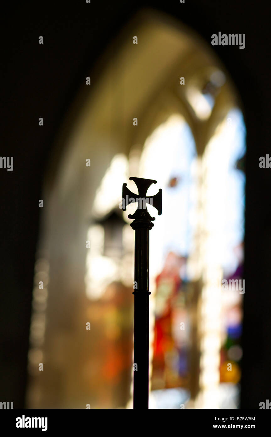 Brass crosses on the end of church pews in an english church - Stock Image
