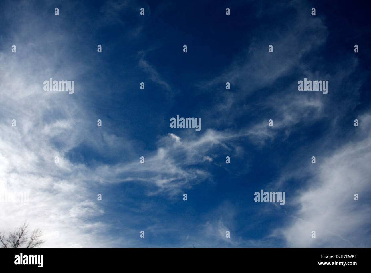 Blue sky with high cirrus or stratocirrus clouds. - Stock Image