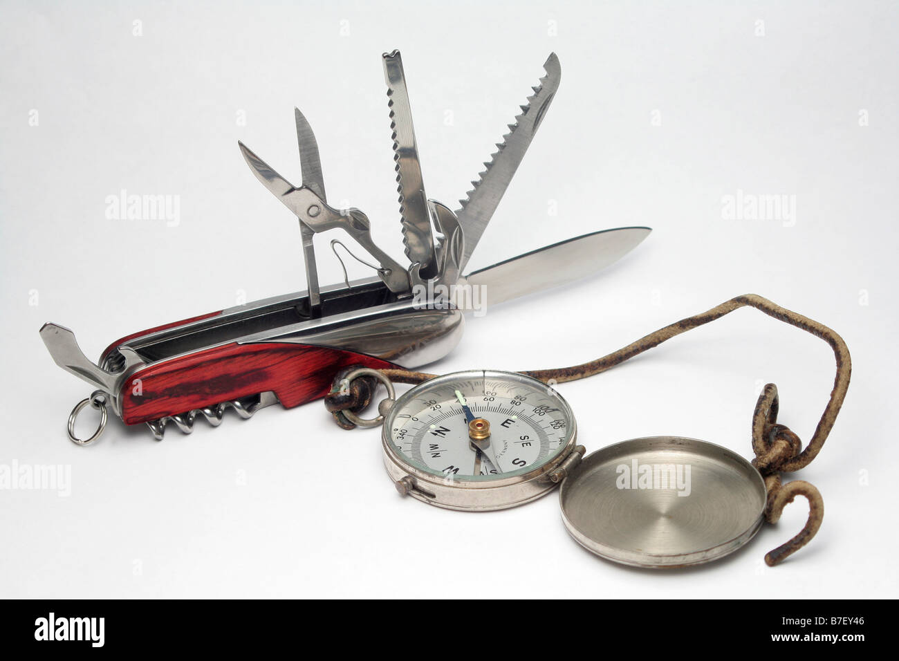 Old compass and multifunction pocket knife - Stock Image