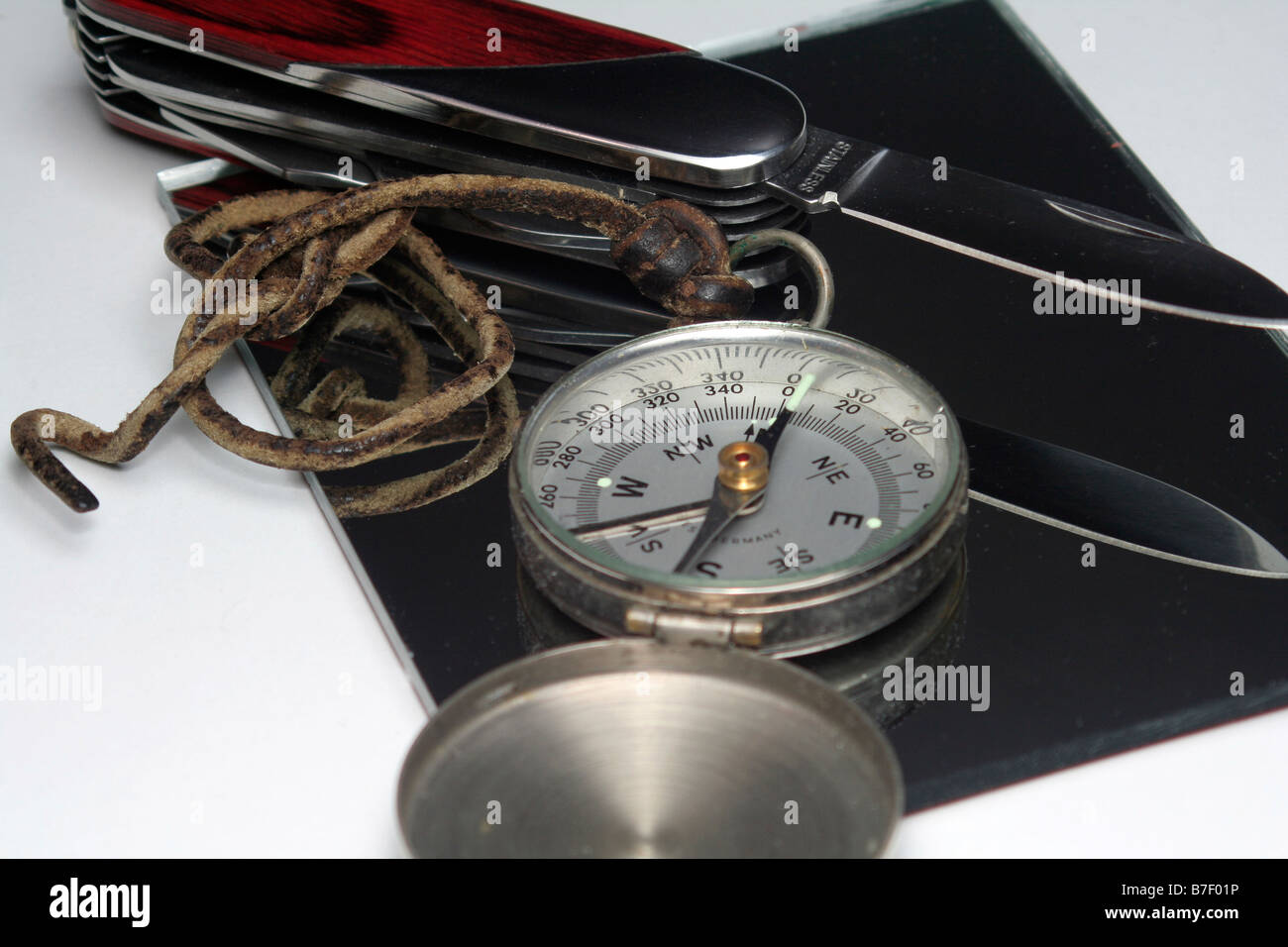 Old compass and pocket knife - Stock Image
