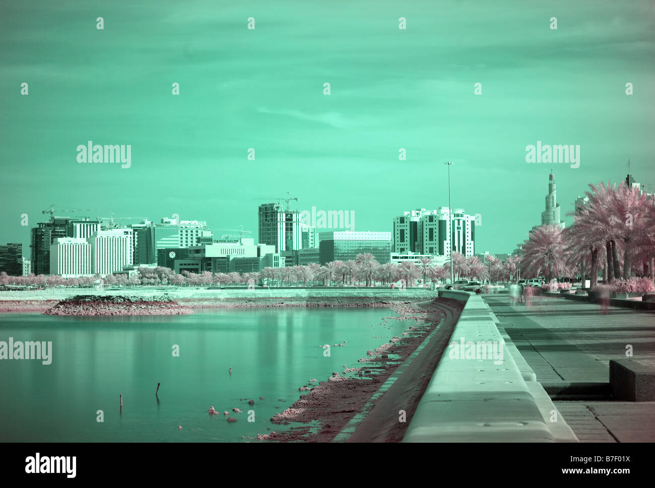 A false coloured infra red view of the Corniche in Doha Qatar with the landmark spiral mosque of the Islamic Centre - Stock Image