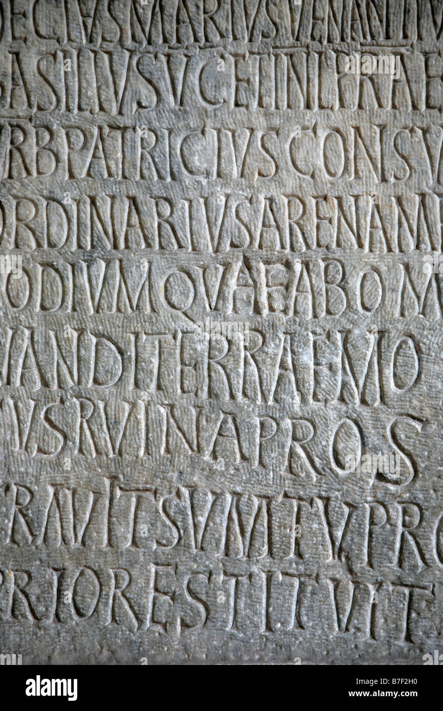 Text on a stone in Coliseum Rome - Stock Image