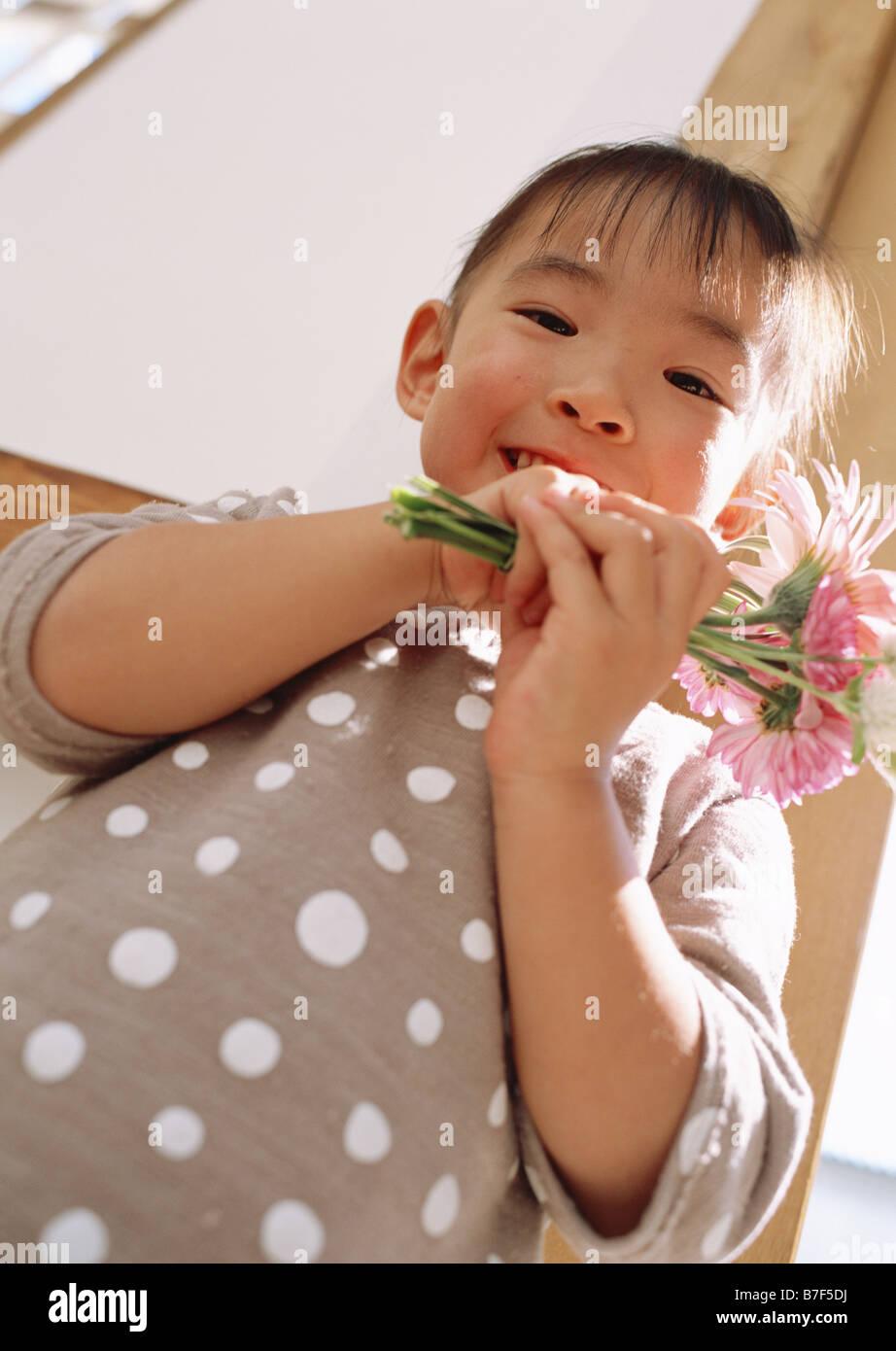 Girl holding flowers Stock Photo