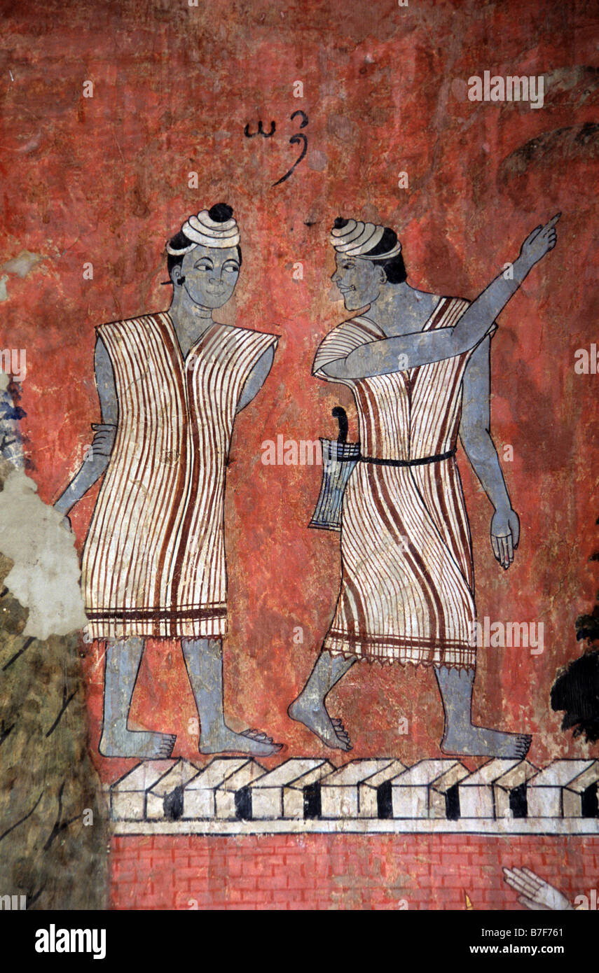 Two Karen Men in Traditional Costume, c19th Mural or Wall Painting by Thit Buaphan, Wat Phumin Temple, Nan, northern - Stock Image