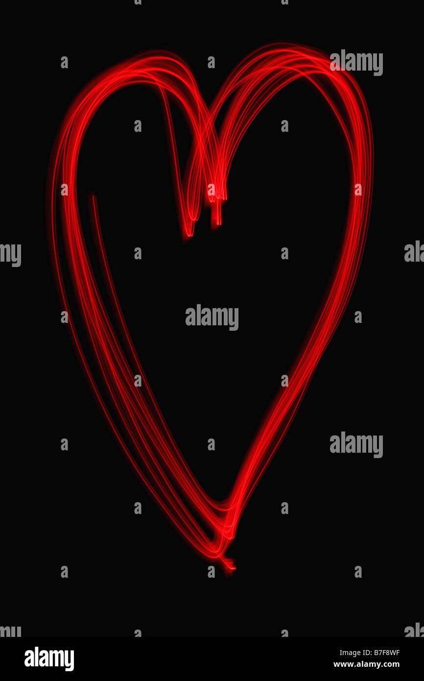 Light painting of a red heart - Stock Image
