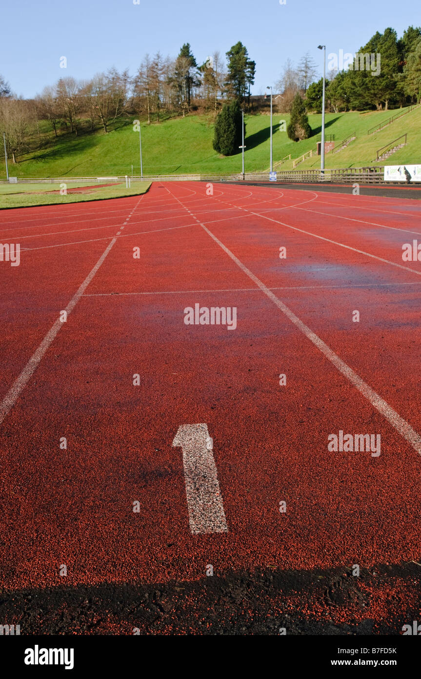 Lane number 1 on an artificial running track - Stock Image