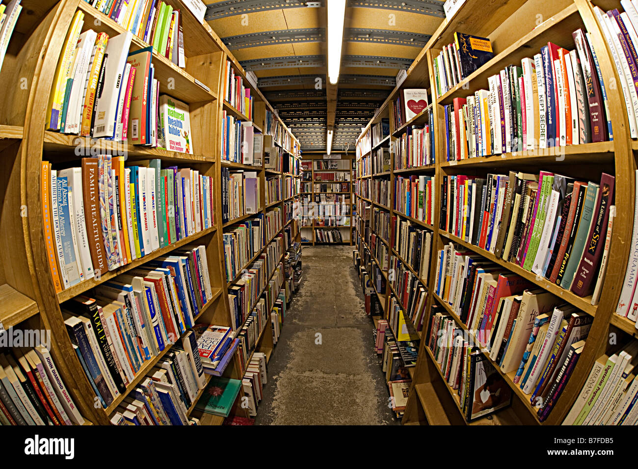 Second hand books on shelves in bookshop Hay on Wye UK - Stock Image