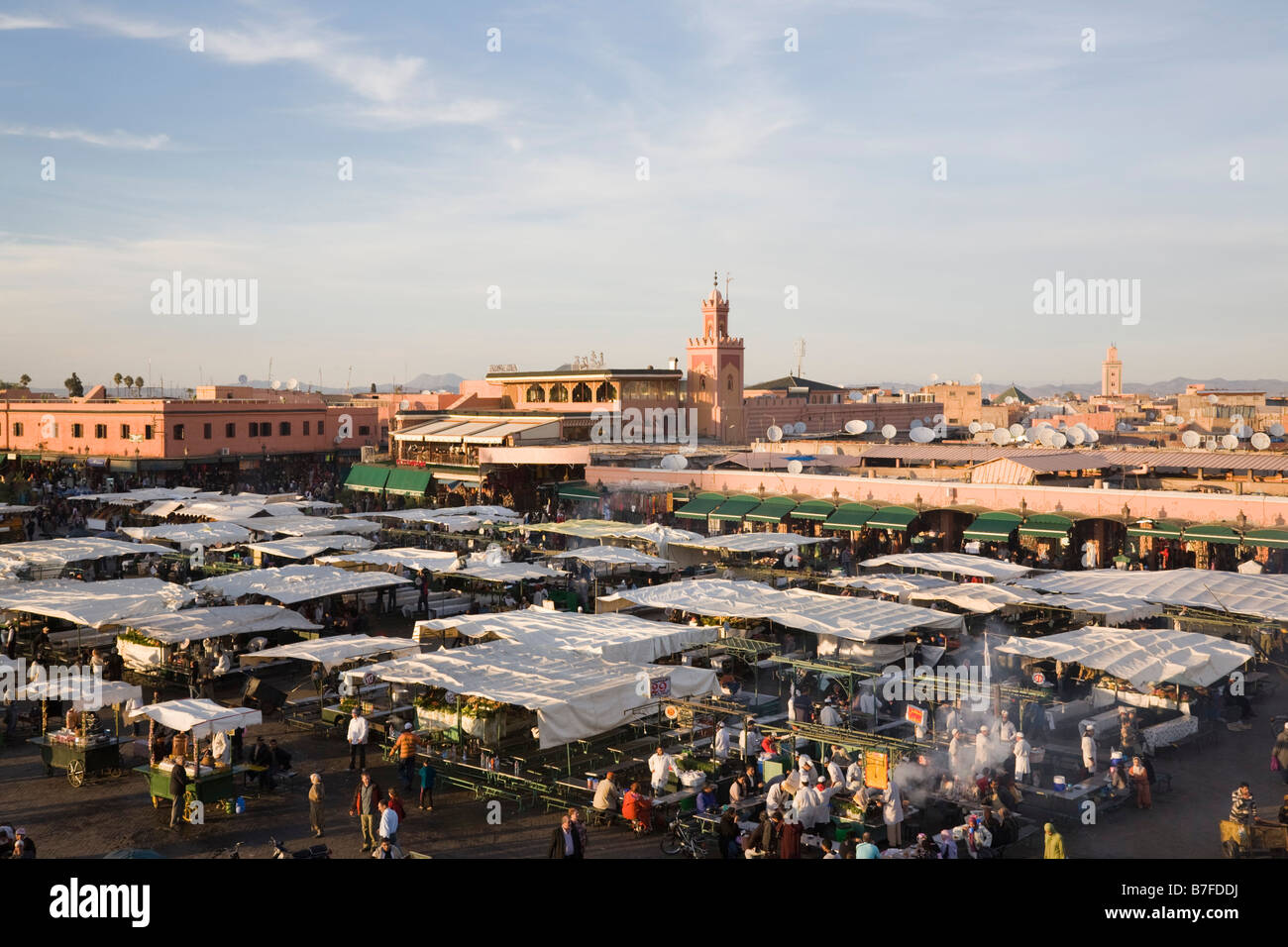 Marrakech Morocco. High view of food stalls and people in Place Djemma el Fna square in early evening in the Medina - Stock Image