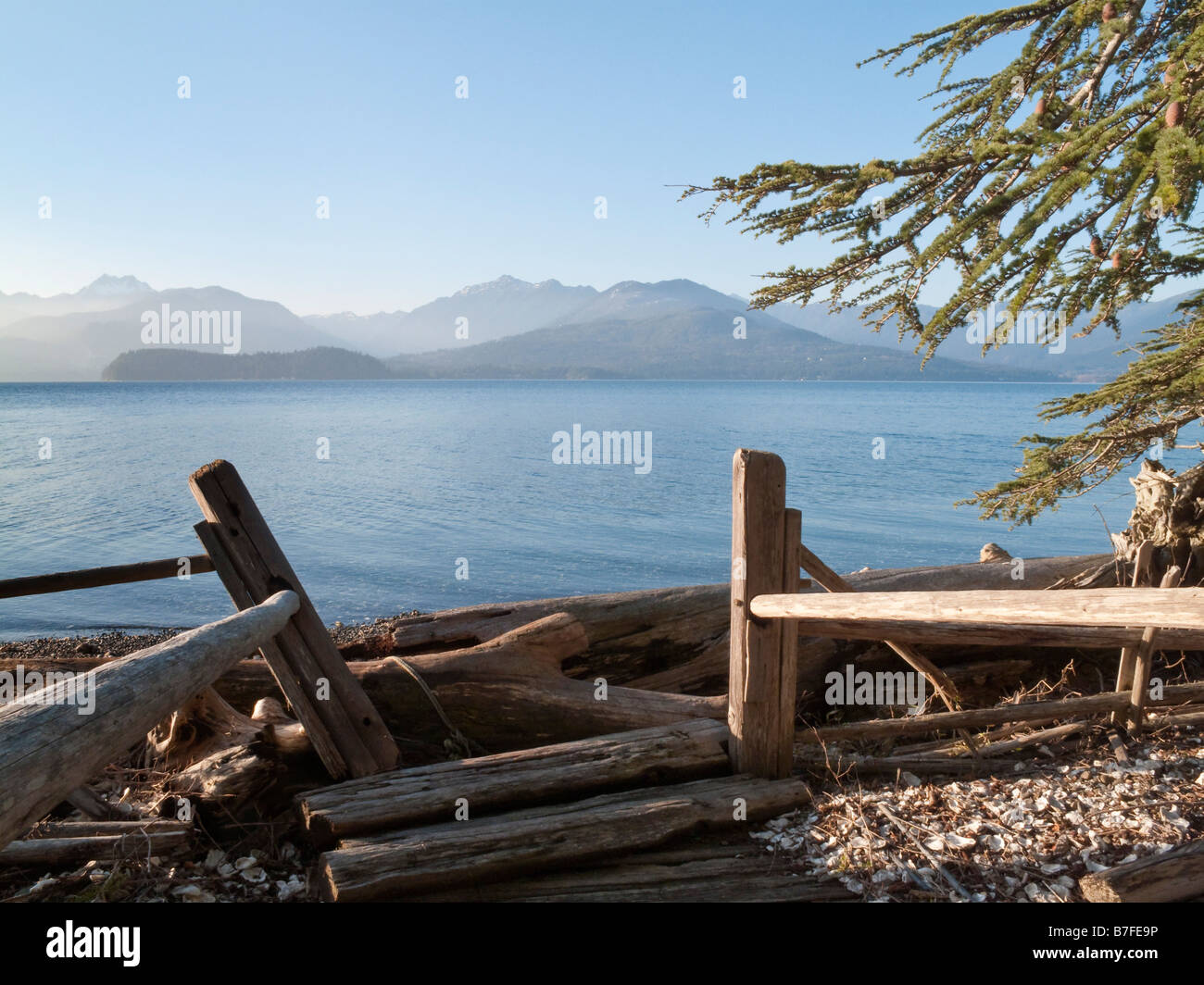 Trail to the Beach on Hood Canal, Seabeck, Washington. Looking at the Olympic Mountains - Stock Image