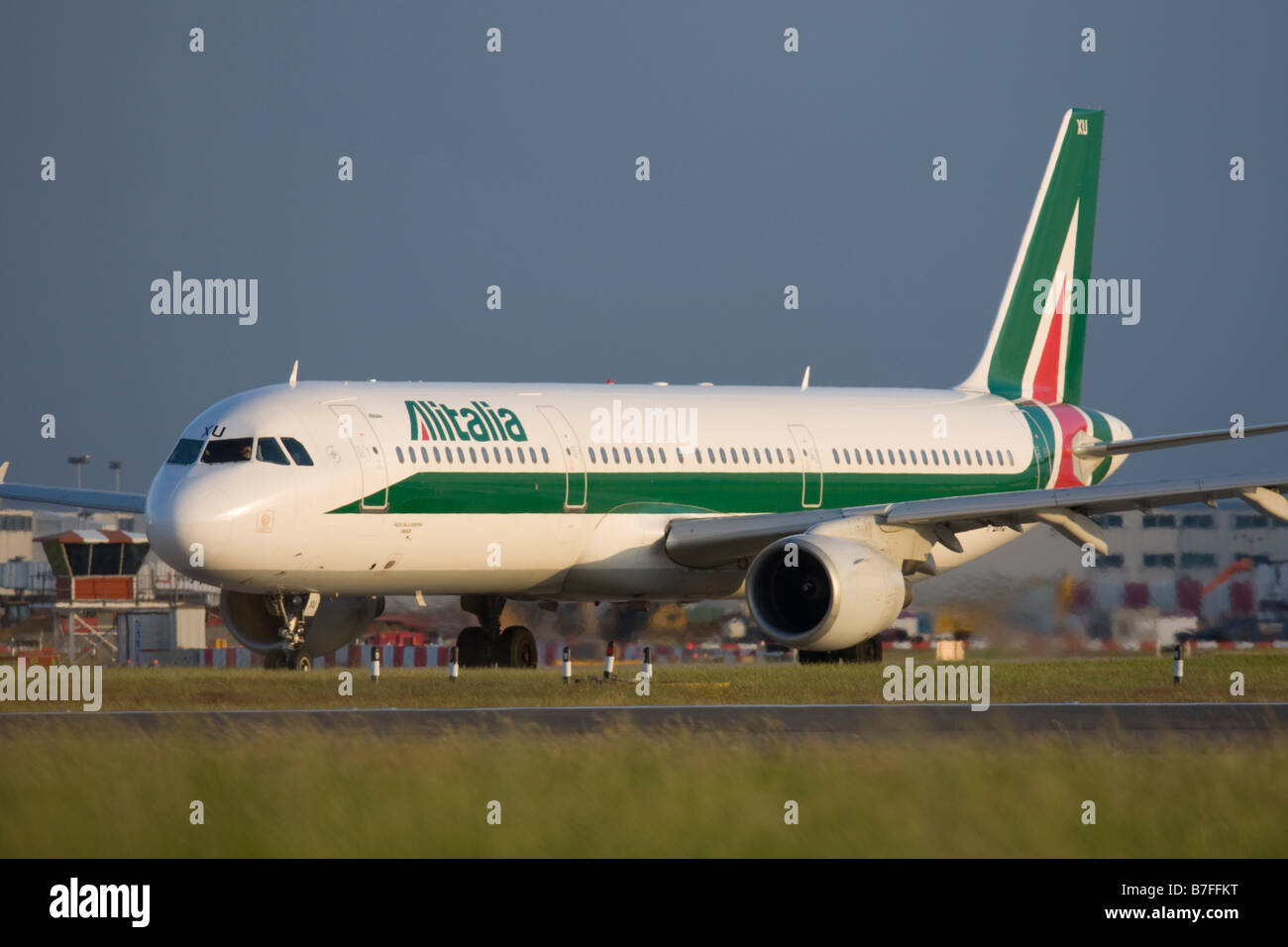 Alitalia Airbus A321-112 taxiing for departure at London Heathrow airport. - Stock Image