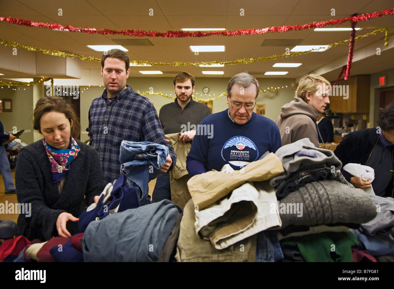Volunteers Sort Clothing Donated for the Homeless - Stock Image