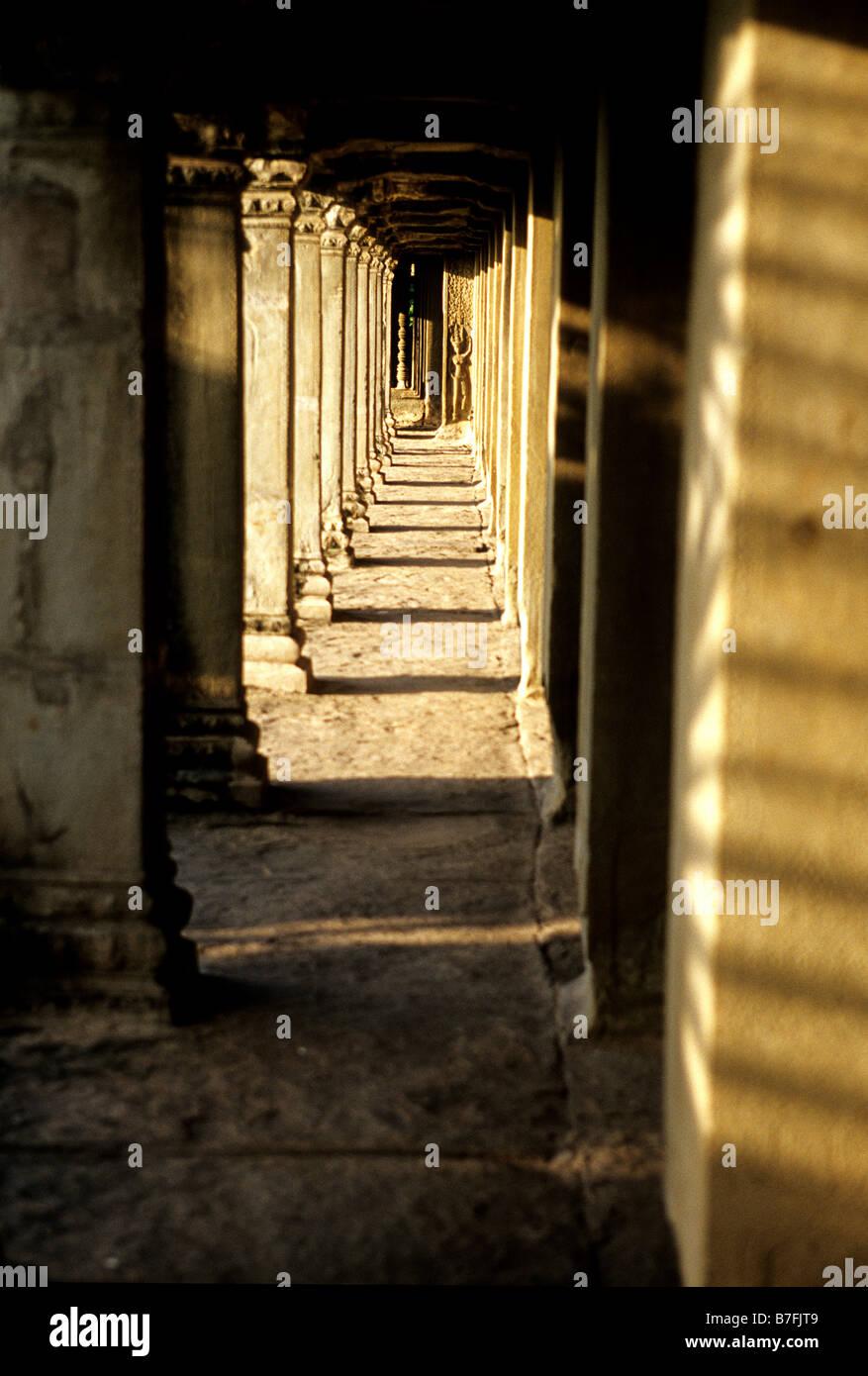 Ruins of  the 12th century Khmer temple of Angkor Wat- Angkor Wat ruins near Siem Reap, Cambodia - Stock Image