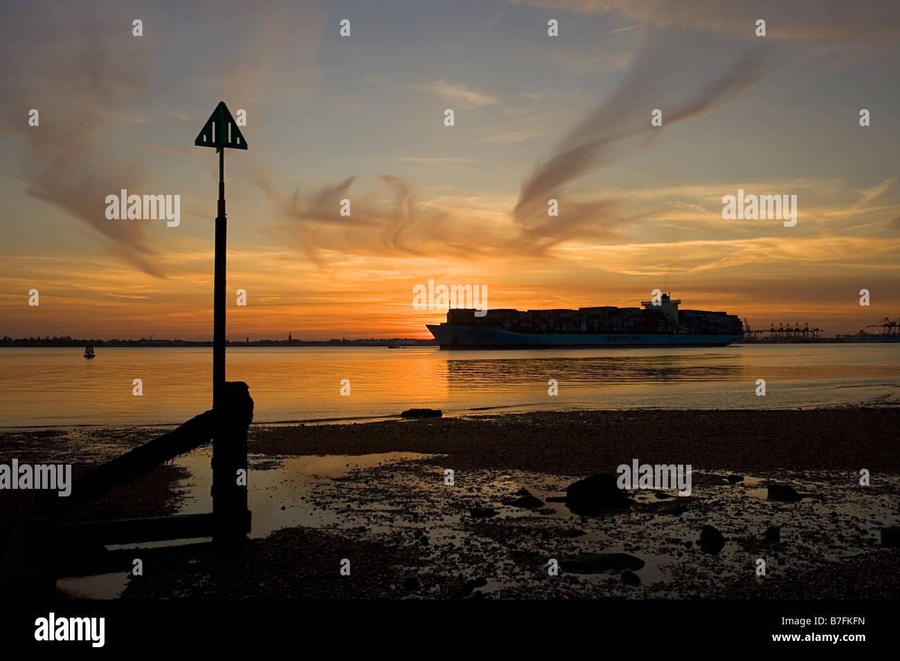Freighter leaving Felixstowe Docks - Stock Image