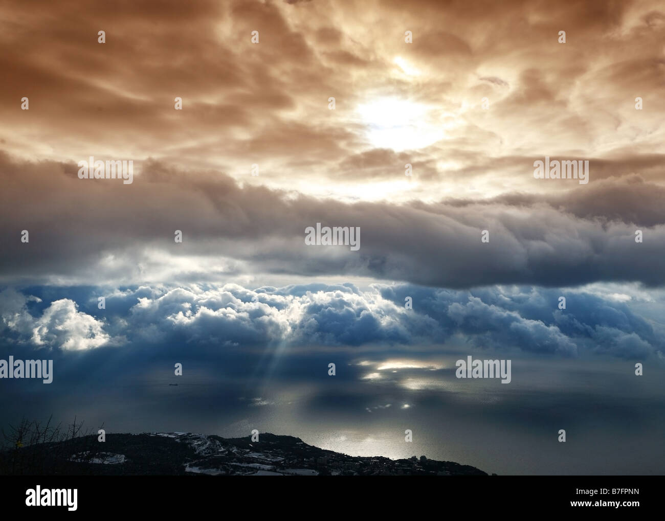 Clouds above a sea - Stock Image