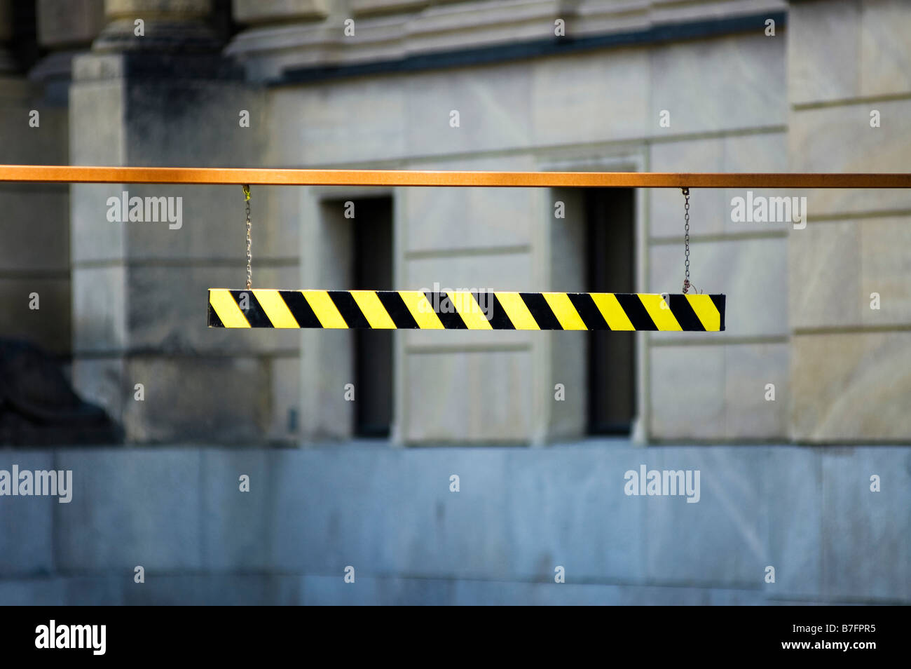 maximum height black yellow barrier over a road - Stock Image