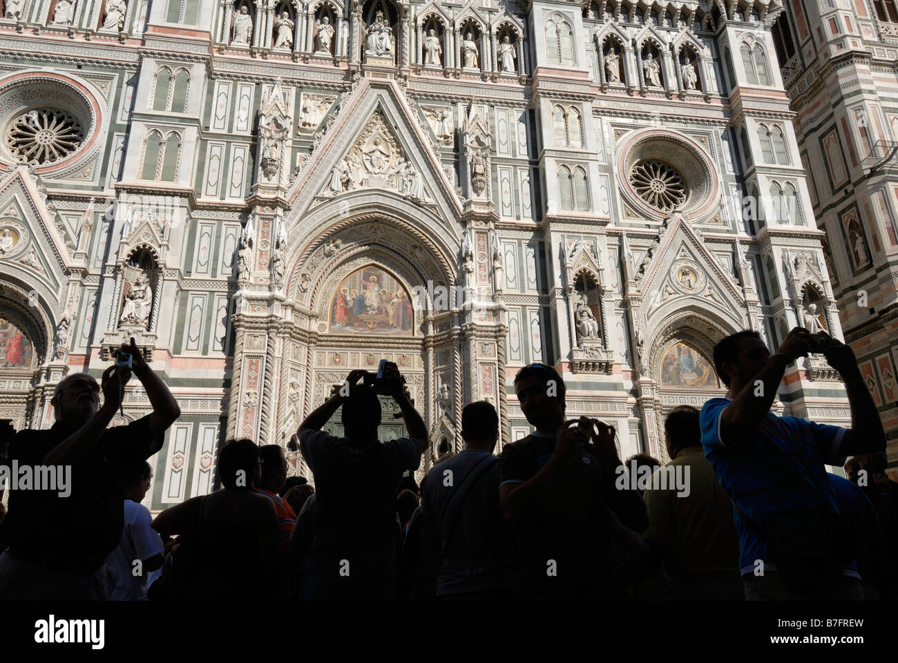 Florence Italy Tourists in front of the Duomo Santa Maria del Fiore - Stock Image