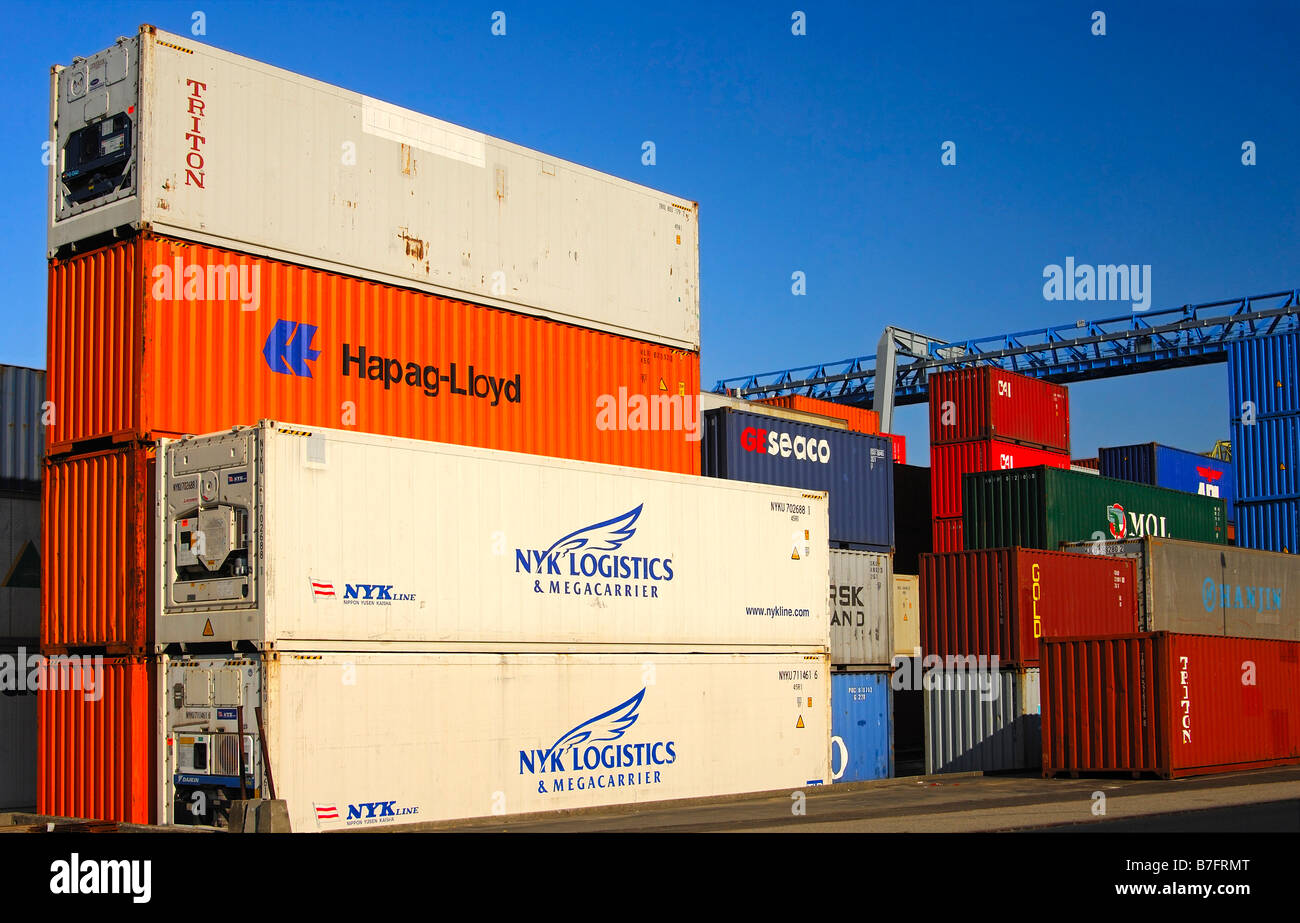 Stacked containers at the container depot of the company Swissterminal AG Frenkendorf near Basle Switzerland - Stock Image
