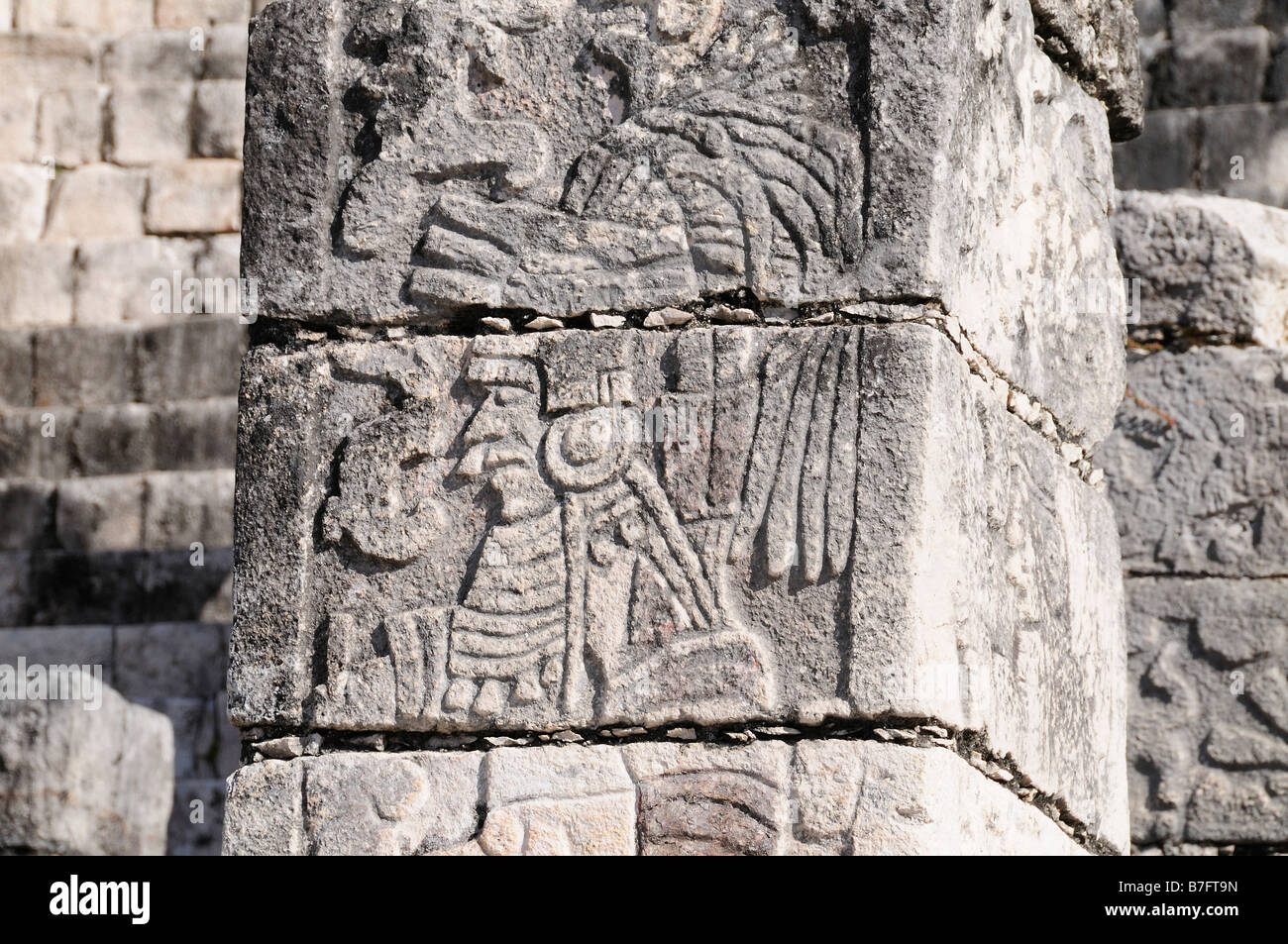 Stone wall carving of Mayan warrior, Chichen Itza, Mexico Stock Photo