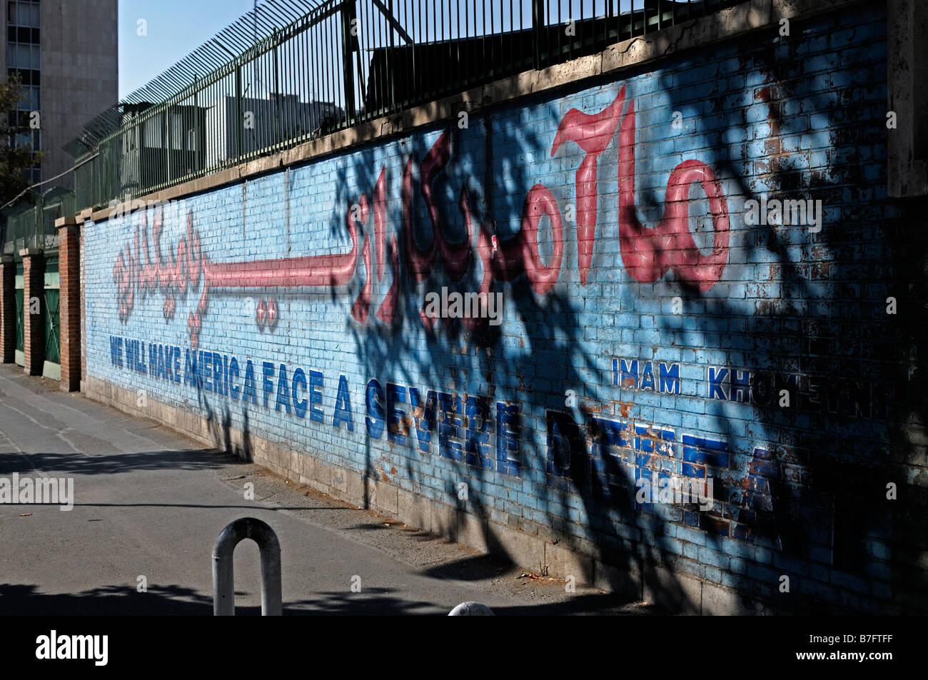 anti american anti-american mural propoganda slogan berate former US united states embassy tehran implied imply - Stock Image